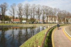 Sul Naviglio - On the canal. (sinetempore) Tags: pavia naviglio canal acqua water riflesso reflection alberi trees nuvole clouds sulnaviglio onthecanal street donna woman
