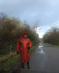Red pvc mac on a wet road (smmack) Tags: red pvc mac boots gloves hooded isolated rain wet road
