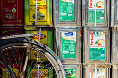 Soybean Oil Tins & Bicycle, Varanasi India (AdamCohn) Tags: adam cohn ganga ganges india uttarpradesh varanasi bicycle soybeanoil streetphotographer streetphotography tin tins wwwadamcohncom adamcohn