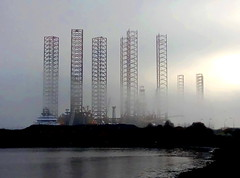 Oil Rigs In The Mist (gcobb84) Tags: rigs oil water bay misty