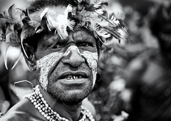Warrior During Mt Hagen Sing Sing, Western Highlands, Papua New Guinea (Eric Lafforgue) Tags: artscultureandentertainment blackandwhite day decoration festival headdress highlands horizontal img3267 indigenousculture jewellery lookingatcamera makeup mounthagen mthagen oneperson outdoors papuanewguinea tourism traditionalclothing tribal tribe singsing ceremony