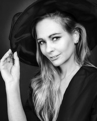 Hattitude (brianjdavies) Tags: portrait studioportrait portraitworld glamour beauty hat blackwhite monochrome lowkey smile glance look eyes
