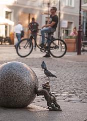 life goes on (annabed) Tags: wroclaw poland polska street streetphotography gnome wroclawsgnomes orangealternative pomaranczowaalternatywa bicycle selectivefocusing city urban olympus oldtown