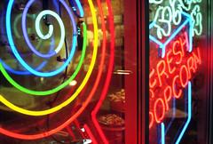 candyland (kaumpphoto) Tags: mamiya nc1000s kodak portra 800 color rainbow neon sign street candy spiral fresh popcorn red yellow green blue orange purple reflection window glass