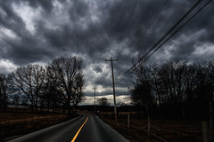 (pacc2008) Tags: road tree clouds cloudjunkie ominous yellow canon 30d 1740mmf4l ishootraw landscape dark telephonepole powerlines chestercounty pennsylvania pa grainmatters grain