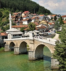 The Old Bridge in Konjic on the Neretva River is considered the point where Herzegovina connects with Bosnia. It was built in 1682. The bridge is made of stone and has six arches. It is one of the most beautiful bridges of the Ottoman period in Bosnia and (Amir Guso) Tags: leute brücke bridges mostovi himmel bucht wasser grad city stadt kuće häuser houses arhitektura architektur architecture canon