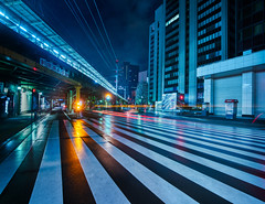Moody Crossing (Trey Ratcliff) Tags: treyratcliff stuckincustoms stuckincustomscom aurorahdr hdr hdrtutorial hdrphotography hdrphoto lines crossing ginza road japan night lights orange blue architecture city