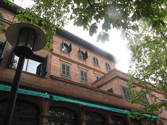 Façade of Principal Building of Residencia de Estudiantes, 1915,  Calle del Pinar, El Viso, Madrid (d.kevan) Tags: façades windows shutters arches reflections awnings brick plants trees streetlamps balconies