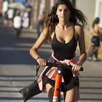 Girl in black on electric scooter thumbnail