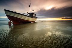 Into the sun. (daveknight1946) Tags: essex southend thorpebay sunset mud riverthames boat fishingboat longexposure fujixt3