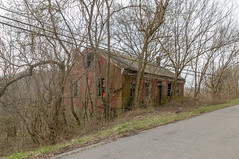Mouser House — Ripley, Ohio (Pythaglio) Tags: house ripley ohio unitedstatesofamerica us dwelling residence historic 15story brick fivebay doublepile german mouser abandoned vacant overgrown browncounty hillside trees slope transom rakeboards 11windows sills