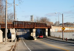Railroad viaduct on S. Kinnickinnic Ave., Milwaukee (Cragin Spring) Tags: wisconsin wi midwest unitedstates usa unitedstatesofamerica milwaukee milwaukeewi milwaukeewisconsin city urban street viaduct sidewalk railroad railroadviaduct