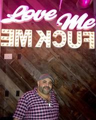 IMG_8182 (danimaniacs) Tags: guy man mansolo neon sign smile beard scruff colorful