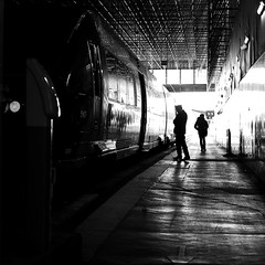 The last passenger (pascalcolin1) Tags: paris13 austerlitz homme man train quay quai lumière light reflets reflection photoderue streetview urbanarte noiretblanc blackandwhite photopascalcolin 50mm canon50mm canon passager passenger gare station phare controleur