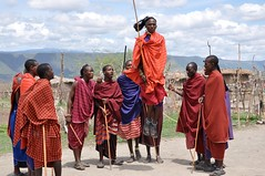 We Are Warriors (The Spirit of the World ( On and Off)) Tags: tanzania eastafrica africa tribes maasai warriors ritual hunter village locals huts people walkingsticks notherntanzania nomaticpeople red dance performance