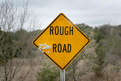 Rough texas (Naity Dhim) Tags: sign rough road roughroad bullets impact gun bulletimpact yellow sel1870z texas austin pedernales