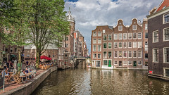 Amsterdam (PhredKH) Tags: amsterdam architecture buildings canon canoneos canonphotography ef2470mmf4lisusm fredkh peoplehavingfun photosbyphredkh phredkh travelphotography trees waterway bars canals people scenicwater water