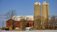 Old red barn with 2½ silos and pickup truck - Brampton, Ontario. (edk7) Tags: nikond60 nikonnikkor18135mm13556gedifafsdx edk7 2011 canada ontario peelregion brampton winter farm barn silo rural country countryside pickuptruck abandoned crusty rusty dome tree sky wood field snow cedarsplitrailfence