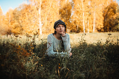 Contemplating (AlexanderHorn) Tags: summer girl woman thinking grass sun green moody portrait