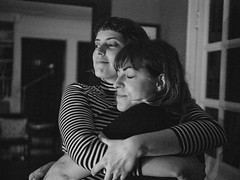 Corrie & Lisa (Zack Huggins) Tags: olympusomdem5markii panasonicleicadgsummilux25mmf14 vscofilm pack06 dallastx oakclifftx home house houseparty dinnerparty friends friendship hug hugs embrace cinematic availablelight lowlight highiso handheld portrait candid bokeh dof microfourthirds bw mono monochrome livingroom night firelight fireplace love
