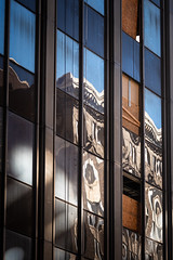 a modern failure (fallsroad) Tags: sigma135 sigma135art tulsaoklahoma city urban fragment architecture building detail windows glass reflections
