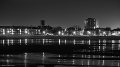 Saltcoats, North Ayrshire (Rourkeor) Tags: mzuikodigitaled12‑100mm140ispro m43 northayrshire omdem1markii olympus saltcoats scotland uk beach blackwhite cars highcontrast highrise houses lightshadows mft microfourthirds nightshot reflections sand streetlights water