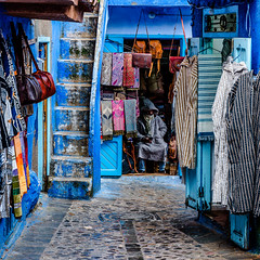 Waiting for customers (bransch.photography) Tags: bluecity color souvenir morocco street shop city chefchaouen azure northafrica architecture wall village berber moroccan gift old souvenirs medina chefchouen town cold culture famous blue historical beautiful house winter colors ancient unesco traditional historic colorful colour