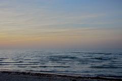 standing on the shoreline (ericgrhs) Tags: shoreline shore beach strand balticsea sea meer ostsee rostock warnemünde sunset sonnenuntergang sundown waves wellen sky himmel