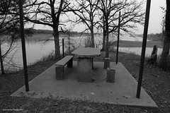 bleak picnic (pvh photo) Tags: lake picnic monochrome table abandoned