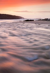 Porth River Sunset (Julian Barker) Tags: porth beach newquay cornwall kernow south west england uk europe sunset dusk stream river flow flowing ripples motion blur island shore shoreline country pink canon dslr julian barker