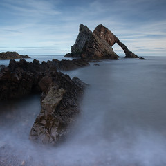 Bow Fiddle Rock (PeskyMesky) Tags: aberdeenshire scotland bowfiddlerock portknockie longexposure water natural arch rock sea ocean wave canon canon5d eos
