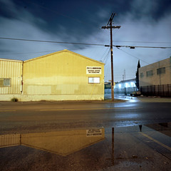 Entrance around the corner (ADMurr) Tags: la eastside rain inverted triangles yellow warehouse clouds night hasselblad 500cm 50mm distagon kodak ektar film dba310 zeiss