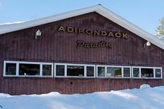 Adirondack Paradise (fotofish64) Tags: sign adirondackparadise building park pinelakepark rustic winter snow texture pattern window caroga fultoncounty newyork adirondackpark adirondacks southernadirondacks seasonal outdoor pentax pentaxart kmount k70 hdpentaxda1685mmlens dwwg