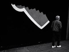 The White Stripe (Feldore) Tags: dublin temple bar street photography man candid white stripe wall shoes ireland irish feldore mchugh em1 olympus 17mm 18 surreal art graffiti