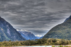 Mount Christina (myshutterworld) Tags: newzealand south island landscape mountains peaks serene picturesque gorgeous southland milfordsound hdr spectacular beautiful mind blowing amazing middle earth heavenonearth lake fiordlandnationalpark cloudy dark blue green water nature sky grass trees rocks fiord snowcapped