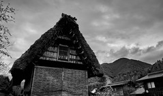 Dramatic sky over Shirakawa-go (KaeriRin) Tags: japan tourism travel bw blackandwhite blackwhite traditional old oldfashioned authentic architecture buildings houses house 建物 家 home shirakawa shirakawago village town sky clouds straw roof sony alpha 7m2 7mii mirrorless a7m2 ilce7m2 28mm20 28mm