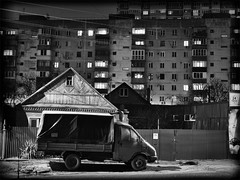 night street, truck and buildings (Pomo photos) Tags: night street car van roof window road urban lowlight epl8 olympus olympus25mm surreal noir tire wood fence wall building house city cityscape shadow light lamp blackandwhite blackwhite bw monochrome mono letters digit ads truck wire