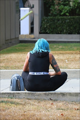 Regret Nothing (HereInVancouver) Tags: woman bluehair belt regretnothing seated reading texting city urban vancouverswestend vancouver bc canada canong3x candid streetphotography tattoos purse