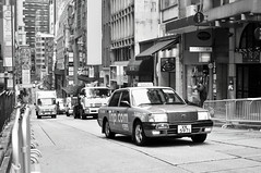 Taxi | Hong Kong (香港), China (Ping Timeout) Tags: hong kong hongkong china sar 香港 island south special administrative region people's republic prc territory december 2018 vacation holiday trip 香港特區 香港特区 outdoor taxi public transport wellington street road central building urban city traffic truck shop scene black white monochrome bw tripcom red 的士 胡忠 1941