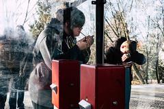 Wind and Sunshine (Art de Lux) Tags: berlin station platform cigarette lighter smartphone blinding ticketvalidator people red street candid artdelux deutschland germany bahnhof bahnsteig zigarette feuerzeug blenden entwerter menschen personen rot summilux mft sbahn