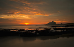 Bamburgh Rock (lynneberry57) Tags: sunrise nature bamburghcastle northumberland coast seascape landscape beach rocks colours light clouds sun canon 70d leefilters water sea tide castle sky orange