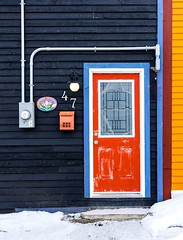 Many Colours (Karen_Chappell) Tags: red door blue house home nfld city urban architecture building stjohns newfoundland downtown trim paint painted wood wooden clapboard mailbox snow yellow orange white canada atlanticcanada avalonpeninsula eastcoast canonef24105mmf4lisusm