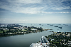 Blue Water (Through the Glass Studios) Tags: photography photo landscape landscapes landscapephotography landscapephoto cloud clouds building buildings street river rivers water singapore marinabay marinabaysands sony sonyalpha sonya7 sonya7ii tamron adobe adobephotoshop adobelightroom photoshop lightroom sea seas ocean oceans vsco vscofilm travel