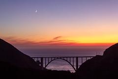Sunset, Moonset (Kirk Lougheed) Tags: bigsur bixby bixbybridge california pacificocean usa unitedstates bridge landscape moon moonset ocean outdoor sea silhouette sunset water