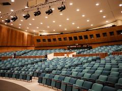 Germany - Berlin - Haus der Kulturen (st3000) Tags: europe oldeurope germany berlin capital hdk hausderkulturen gm5 lumix 20mm green chairs indoor auditorium lights hall