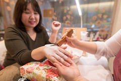 Young nailst applying special cream to her client (Apricot Cafe) Tags: img70170 adultsonly asia asianandindianethnicities expertise healthcareandmedicine healthylifestyle japan japaneseethnicity millennialgeneration sigma20mmf14dghsmart tokyojapan applying artist beautyproduct beautyspa beautytreatment bodycare brush business businesswoman candid capitalcities carefree charming cheerful citylife colorimage confidence cream day fashion indoors lifestyles nailpolish nailsalon onlyjapanese onlywomen people photography professionaloccupation realpeople relaxing satisfaction sitting smallbusiness smiling success twopeole waistup women working youngadult
