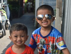 teeth and daddy's sun glasses (the foreign photographer - ฝรั่งถ่) Tags: two boys teeth sunglasses khong lard lat phrao portraits bangkhen bangkok thailand nikon d3200 happyplanet asiafavorites