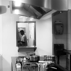 In the small cooking (pascalcolin1) Tags: paris homme man nuit night cuisine kitchen lumière light table casserole photoderue streetview urbanarte noiretblanc blackandwhite photopascalcolin 50mm canon50mm canon