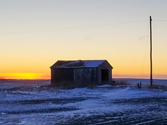 Abandon shed at sunset (darletts56) Tags: sky blue cloud clouds orange yellow gold golden sun sunset evening night dusk snow winter prairie field fields building shed old abondon ruff pole wire line power grass cold saskatchewan canada wires lines country flat land landscape farm farms barn decay