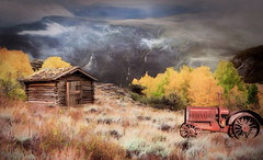 High In The Mountains (jarr1520) Tags: sky clouds mist fog mountains composite textured grasses outdoor landscape tractor abandoned trees farm